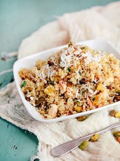 Pineapple Chicken Quinoa Salad - this salad recipe is an easy to make one bowl meal idea. Hearty enough to keep the hunger pangs at bay for the rest of the day. It is a really healthy, nutrition packed meal. Serve it as a side dish with dinner or a light main course. It combines flavors & textures with crunchy nuts, sweet dried pineapple, & quinoa, for a one dish meal. Instead of a sandwich for lunch, try this quinoa salad in a lettuce wrap! on www.goodlifeeats.com @goodlifeeats