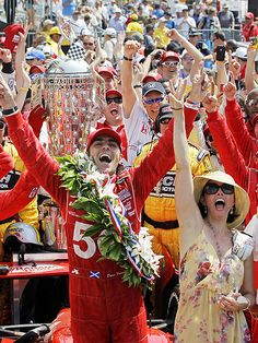 TRIPLE CROWN    She's his biggest cheerleader! Ashley Judd triumphantly stands by her husband, race car driver Dario Franchitti, while celebrating his third Indy 500 victory at the Indianapolis Motor Speedway on Sunday.