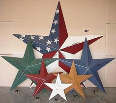 We'll blame it on my Nebraska roots (b/c yes, they are a little country), but I love these metal stars.  I have the flag patterned star up on my front door right now and have smaller white ones on my buffet.