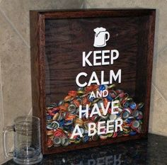 """Use A Picture Frame, Paint On Your """"Keep Calm"""" Saying And Cut A Hole At The Top To Drop Caps In!"""