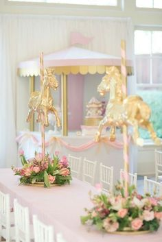 DIY centre pieces for baby shower - spray paint toy horse and glue stick at top and bottom