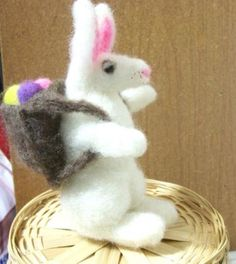 easter bunny soft wool sculpture  The backpack comes off and the 'eggs' come out.