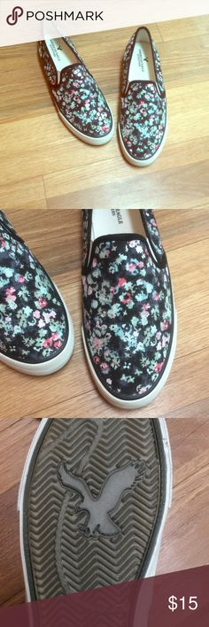 American Eagle Floral Slide-On Sneakers Super cute and in excellent condition! There is however one tiny hole where the eagle is on the bottom of the right shoe. This does not effect the shoe. From my pet and smoke free home. No trades, please! American Eagle Outfitters Shoes Sneakers