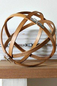 s 19 random thrift store finds become outrageously awesome decor, home decor, repurpose household items, repurposing upcycling, Embroidery Hoops Into Orb After #homedecoritems