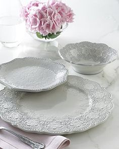 The Merletto Antique collection is crafted using a delicate glaze over rich, black clay. The pattern is inspired by handmade, antique Italian lace that is hand-pressed into the ceramic prior to the application of the glaze. The beautiful, vintage design in creamy white and intricate details all combine to create a unique and charming table setting. Handmade in Italy.    As seen in Elle Decor magazine July 2011 issue!