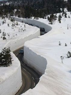 From November to April in Toyama Prefecture in Japan snow is so much that we have to cut through the canyon to the road. Snow depth in some places up to 20 meters.
