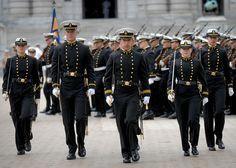 U.S. Naval Academy Midshipmen march through Tecumseh Court on schools campus.
