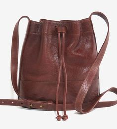 Made with Italian buffalo leather, this bucket bag features richly dyed hues and natural texture in the leather grain