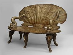"""Venetian Grotto (19th cent.) silver gilt settee with carved seashell design seat and back and dolphin arms DIMENSIONS 56""""w x 28""""d x 37¼""""h"""