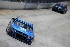 Dale Earnhardt Jr. Photos - Dale Earnhardt Jr, driver of the #88 Nationwide Chevrolet, races during the NASCAR Sprint Cup Series AAA 400 Drive for Autism at Dover International Speedway on May 15, 2016 in Dover, Delaware. - NASCAR Sprint Cup Series AAA 400 Drive for Autism