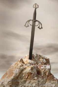 Excalibur ~ King Arthur's sword: in one version of the legend, he draws it out of a stone; in another, it is given to him by the Lady of the Lake