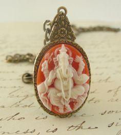 Ganesha  - Vintage Brass Pendant ( Etsy:: http://www.etsy.com/listing/77477660/necklace-elephant-vintage-brass-pendant?ref=v1_other_2 )