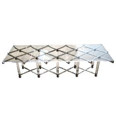 """A nickel plated steel and acrylic """"Treillage"""" cocktail table. Circa 1970's 