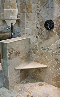 #thetileshop Love this shower! The seat is Great and I Love the Tumbled rock tiles