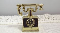 Brass Miniature Dollhouse Furniture Figurine, Collectible Cradle Telephone, Mini Gold-tone Phone by OutrageousVintagious on Etsy Miniature Dollhouse Furniture, Dollhouse Miniatures, Etsy Shop Names, Telephone, Belt Buckles, I Shop, Brass, Antiques, Metal