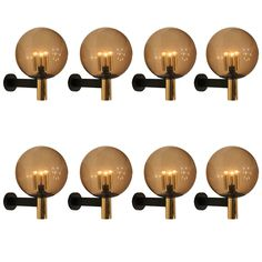 Eight Extra-Large Wall Sconces Smoked Glass with Brass Details, 1970s | See more antique and modern Wall Lights and Sconces at http://www.1stdibs.com/furniture/lighting/sconces-wall-lights