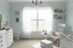 Soft pastel colors, with pops of gold give this pastels and gold nursery a pretty yet modern feel, all while being soothing and calming for the new baby.