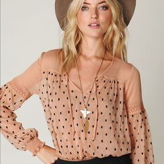 Free people boho top Sheer pink with polka dots. Lace detail on the sleeves XS Free People Tops Blouses