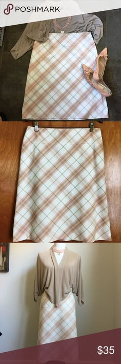 "Burberry London Pink Plaid Lined Skirt Sz 10 Authentic Burberry pink plaid A-line skirt. Side zipper, 2 faux pockets. Made in Italy. 83% cotton, 13% polyamid, 2% elastane. Pre-owned. Skirt has two tiny and hardly noticeable spots in front (see pictures). Otherwise it is in perfect condition. Measurements laying flat: Waist 17"" Length 24"" Burberry Skirts A-Line or Full"