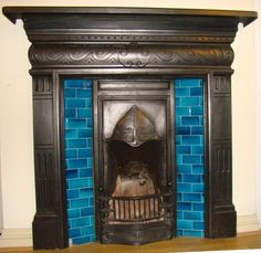 Genuine Edwardian fireplace.   Like the Art Deco ish style and the blue tiling.