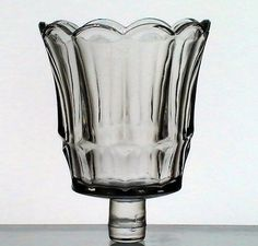 Home Interiors Peg Votive Candle Holder Clear Starlight 11901BD  Simple fluted and flared design. Style resembles a small old fashioned ice cream cup.  Brand: Home Interiors / Homco MPN: 1190-1BD Height: 3.5 inches (including stem) Width: 3 inches Style Name: Starlight Color: Clear Material: Glass