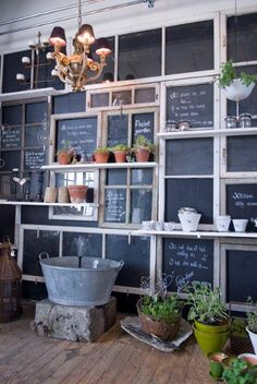 Wall of Repurposed windows and chalk board paint! This would look fantastic in a coffee shop or restaurant! From: me and Alice: Norrgården!
