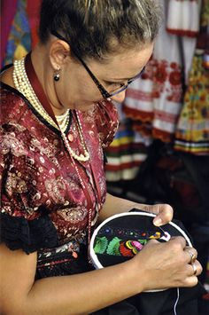 Bernadett Papp of Mező kövesd displays her skills of embroidery. Photo courtesy of Office of Intangible Cultural Heritage, Hungarian Open Air Museum