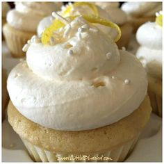 Today I have another sweet treat from my sister's kitchen in Alaska.Lemon Cupcakes with Lemon Curd Filling and Lemony Whipped Cream Frosting. My sister has been making these delicious cupcakes for Lemon Whipped Cream, Whipped Cream Frosting, Lemon Frosting, Frosting Recipes, Cupcake Recipes, Buttercream Frosting, Dessert Recipes, Gourmet Cupcakes, Baking Cupcakes