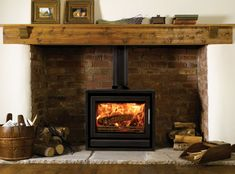 What is the Difference between a Wood Burning and Multi-Fuel Stove? Wood Stove Hearth, Wood Burner Fireplace, Inglenook Fireplace, Brick Fireplace, Fireplace Design, Fireplaces, Primitive Fireplace, Wood Burning Logs, Modern Wood Burning Stoves
