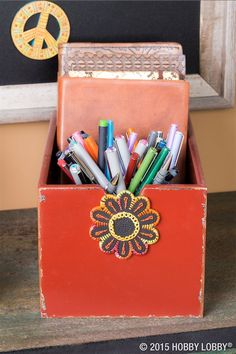 Variegated floss gives this flower embellishment its color-change appeal. Plant a piece like this on a nondescript box, and you've grown yourself a posh-in-petals desk caddy.