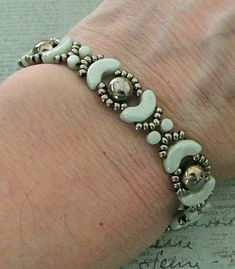 "JOLIE BAND   11/0 seed beads Miyuki ""Nickel Plated"" (190)  8/0 seed beads Toho ""Nickel Plated"" (711)  6mm 2-hole cabochons ""Jet Argentic..."