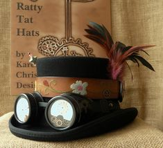 Excited to share the latest addition to my #etsy shop: Steampunk top hat with goggles and watch parts - Little Chelsea - Ladies small or Child's size, Handmade, Unique, Mad Hatter, Tea Party Hat. http://etsy.me/2DhaiYU #accessories #hat #black #rainbow #steampunktophat
