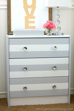 a thoughtful place Ikea dresser with stripes. Super easy project.