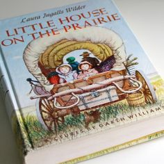 I read the Little House books while lying on my stomach on the living room couch with the books on the floor and one arm dangling down to turn the pages ... my favorite reading posture as a kid.