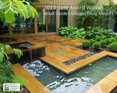 Interior courtyard design. Beautiful deck with fountain and pond