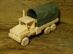 Handmade original design wood toy army truck. 12 3/4 inches long and 4 inches wide, wheels all turn. Made from pine, spruce, maple (wheels),