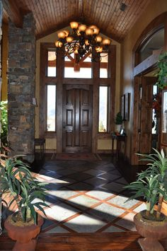 Tile entrance and wood floors. Having the entrance a combination of both, with the tile floors with the wood floors inter-twined. Future House, My House, Foyer Flooring, Wood Flooring, Foyer Decorating, Entry Foyer, Rustic Entry, Entry Doors, Open Floor
