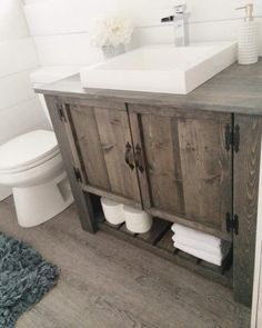 Love the DIY rustic bathroom vanity cabinet @istandarddesign Tap the link now to see where the world's leading interior designers purchase their beautifully crafted, hand picked kitchen, bath and bar and prep faucets to outfit their unique designs.