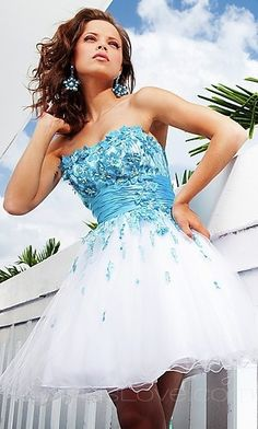 Pretty blue and white dress. Easter maybe with white tights and croppedwhite or blue sweater.