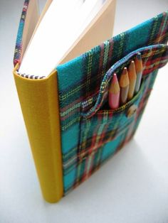 Pencil pouch as an elastic band so main patchwork cover does not loss up when book open