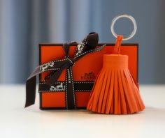 Spruce up your bag with this adorable Hermes tassle keychain from shopedropoff.com