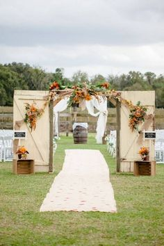 Old Wedding Barn Doors With Wooden Boxes & Barrels // 10 Rustic Old Door Wedding Decor Ideas For Outdoor Country Weddings