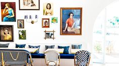 Gallery wall in an all white dining space with striped pillows and Paris bistro chairs // Halcyon House