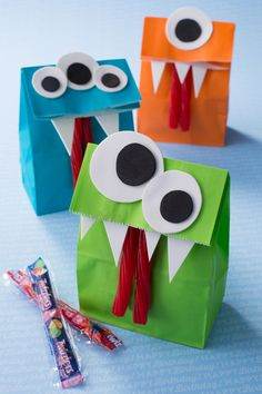 DIY TWIZZLERS Monster Goodie Bag — Goodie bags are meant to be fun. This simple DIY goodie bag is easy to make and will be sure to make the kids scream for more! What you'll need: HERSHEY'S Birthday candy, including TWIZZLERS Pull 'N' Peel, colored paper bags, adhesive and white and black foam sheets Cut out eyes and teeth, glue onto the bag, adhere TWIZZLERS, fill and enjoy! Let's make your child's party the sweetest celebration ever, with HERSHEY'S Birthday candy. Let's Birthday!