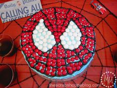 {Brilliant Spiderman Cake} This looks like a cake  even I could pull off!    Totally love the idea of doing the red part in m's -- would eliminate the need for toxic red frosting!