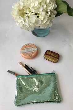 1c454eb782 Leather zipper top pouch in foil mint. The zip pouches make great purse  organizers