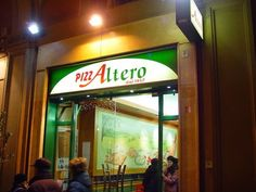 Altero pizza al taglio. OMG can't believe I found this picture! I've never had pizza before or since this good.