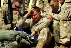 Soldier in tears as he is presented with the flag honoring his fallen brother. So sad