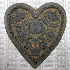 100% Beeswax -tinted black and hand poured into an excellent reproduction of a heavily carved European cookie mold. This is a generously sized heart