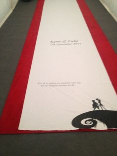 """The Nightmare Before Christmas aisle runner, reads """"For it is plain as anyone can see, we're simply meant to be"""" See the rest of my wedding at -> http://saladtoppings.wordpress.com/2014/11/17/my-disney-themed-wedding/"""